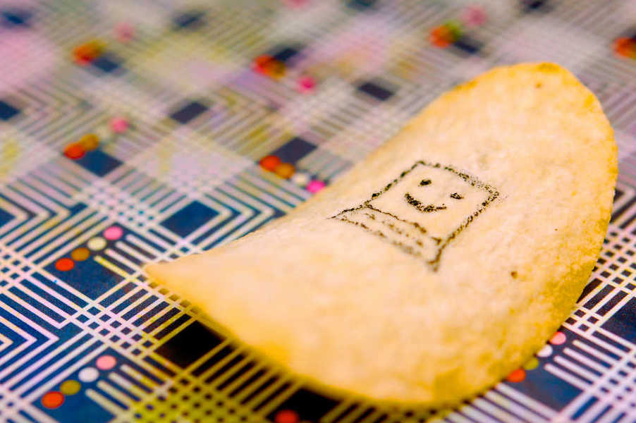 Photo of a potato chip with a computer drawn on it