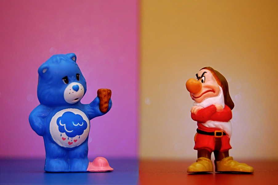 Photo of Grumpy Bear losing his ice cream while Grumpy the dwarf looks on