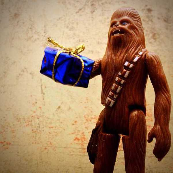 Photo of Chewbacca holding a gift