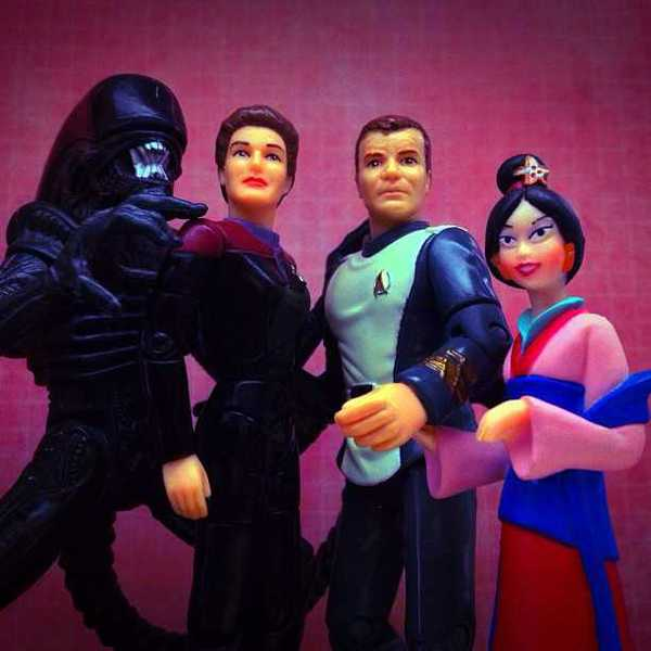 Photo of an alien, Captain Janeway, Captain Kirk, and Mulan