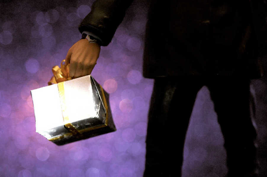 Photo of a person holding a birthday gift