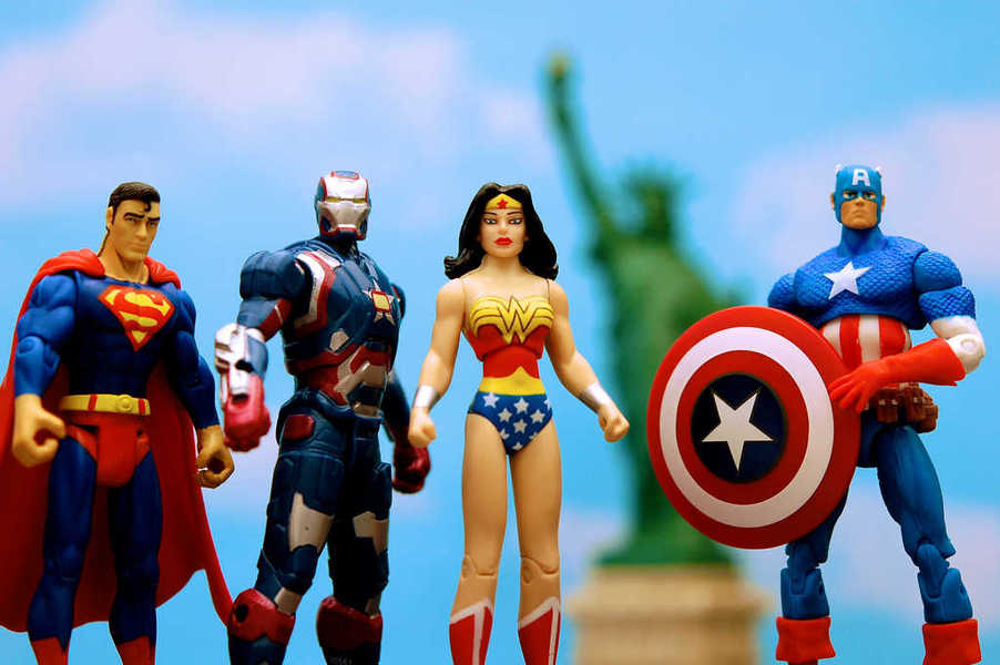 Photo of several superheroes and the Statue of Liberty