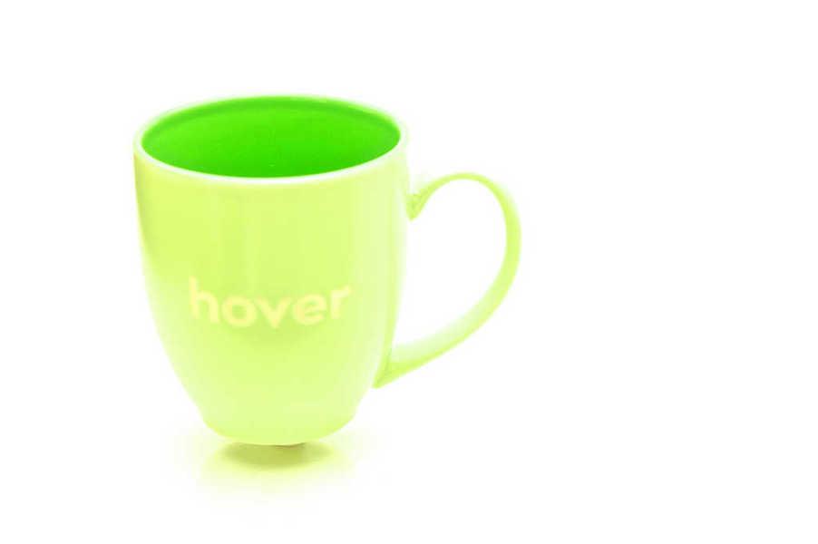 Photo of a green mug bearing the word hover