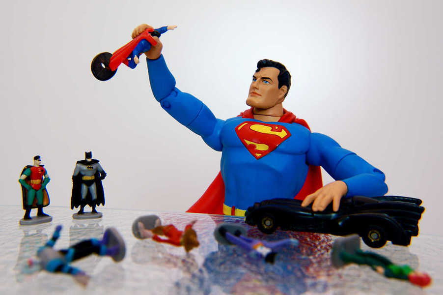 Photo of Superman playing with action figures