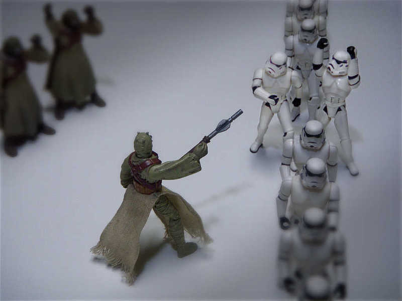 Photo of sand people instructing stormtroopers to walk single file