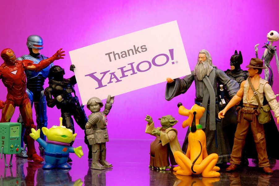 Photo of a group of characters holding up a sign thanking Yahoo!