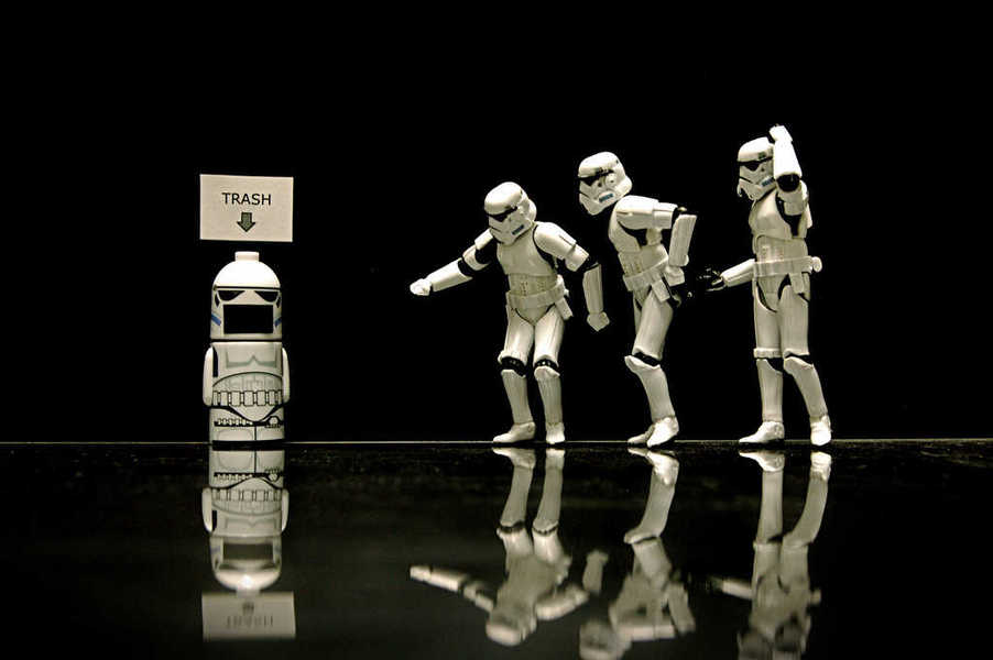 Photo of several stormtroopers approaching a stormtrooper-themed trash can