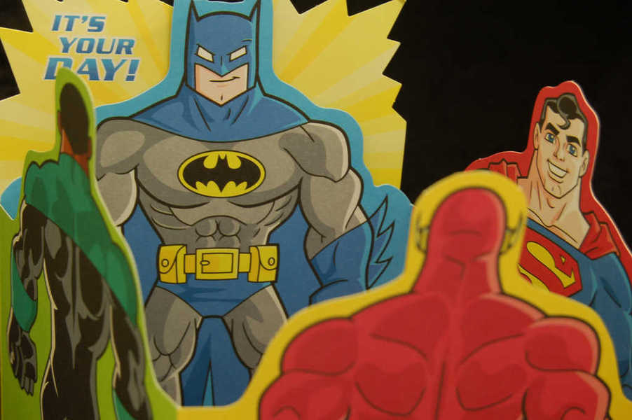 Photo of a birthday card featuring superheroes