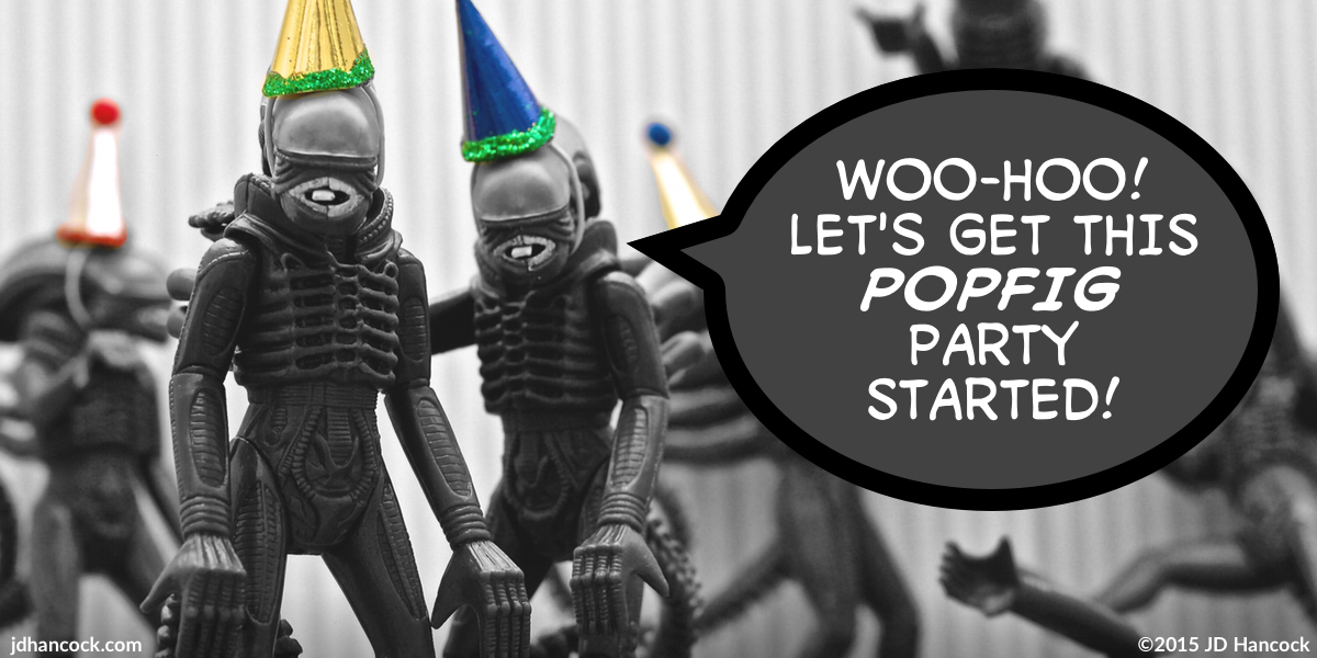 PopFig toy comic with aliens from the film Alien with party hats.