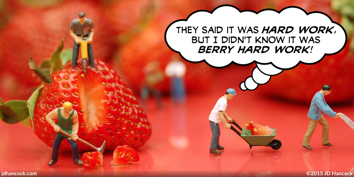 PopFig toy comic with little people processing huge strawberries.