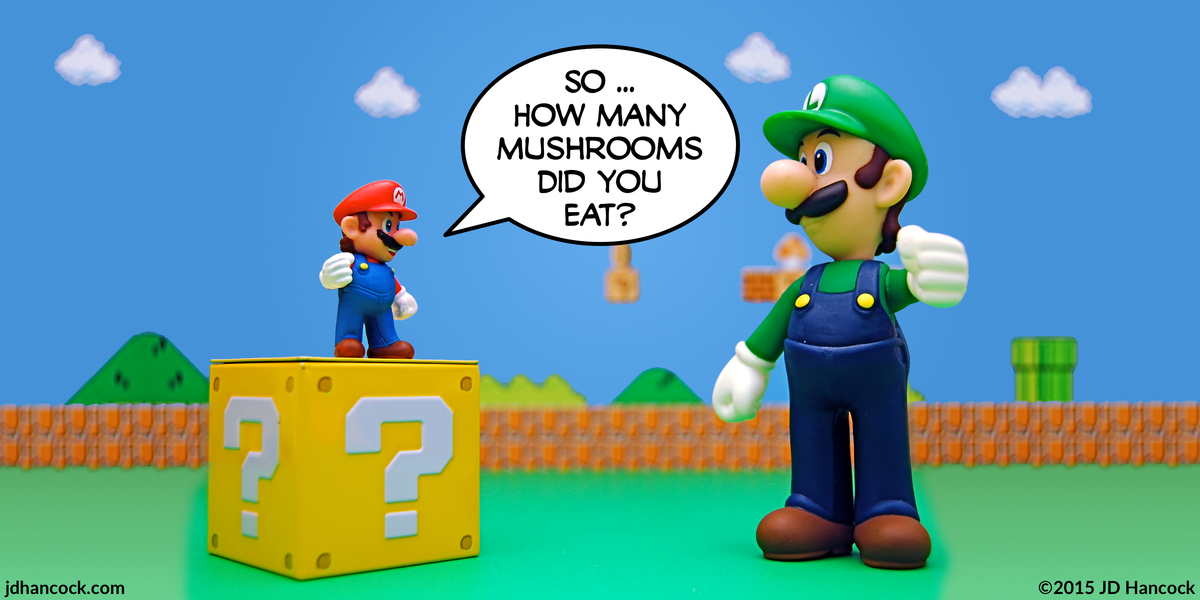 PopFig toy comic with Mario and an over-sized Super Luigi.