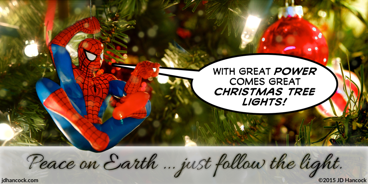 PopFig toy comic with Spider-Man hanging inside a Christmas tree.