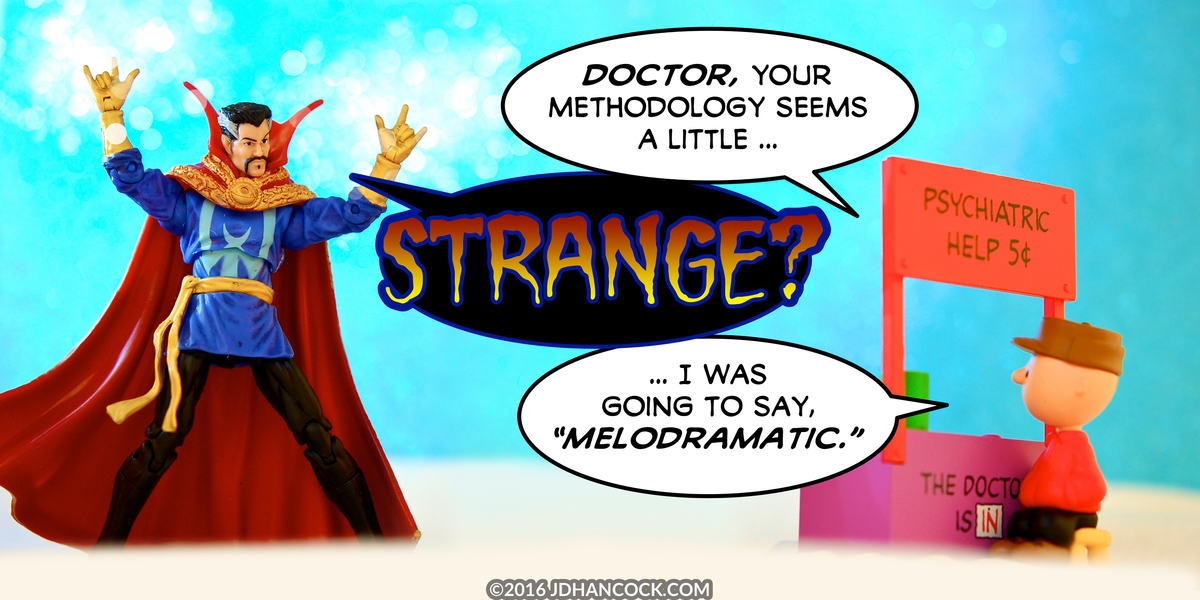 PopFig toy comic with Doctor Strange and Charlie Brown.