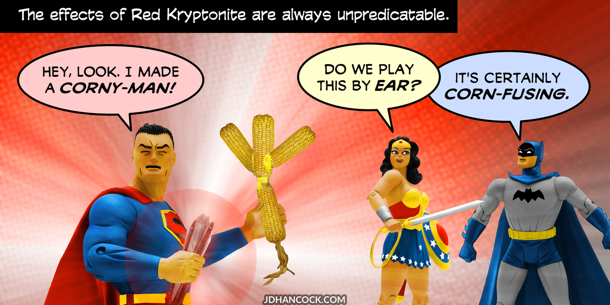 PopFig toy comic with Superman, Wonder Woman, and Batman.
