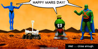PopFig toy comic with several Martians and a NASA rover.